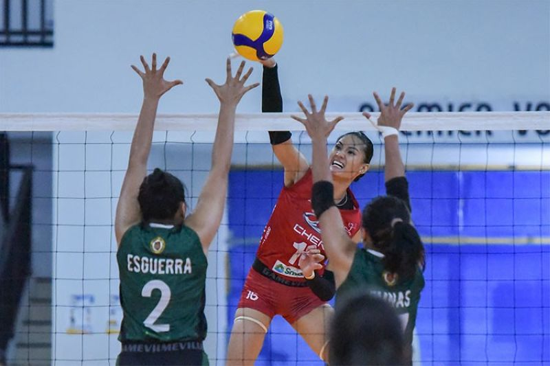 MANILA. Dindin Manabat uncorks a power hit against Army's Esguerra and Nunag that more than underscored the Chery Tiggo Crossovers' determined drive to the semis. (PVL)