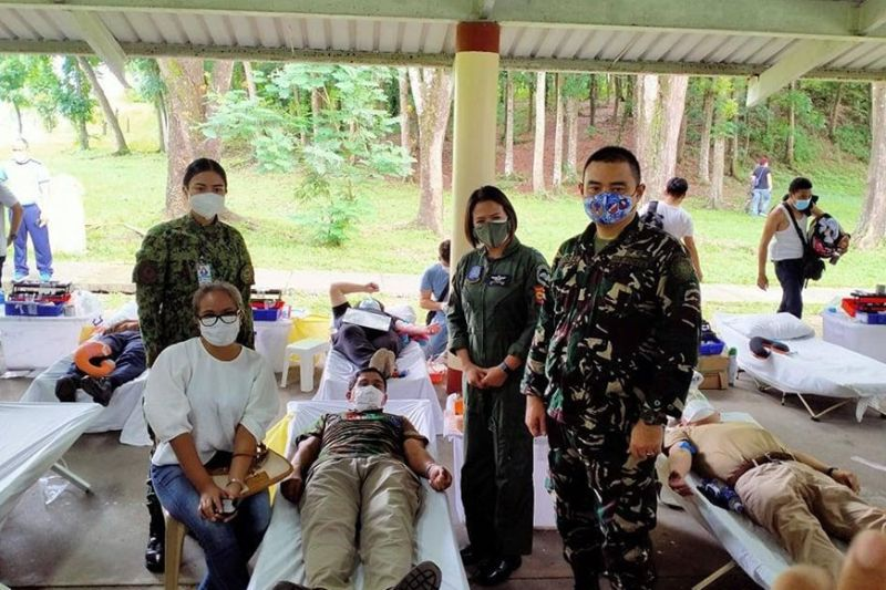 BLOODLETTING. Reserve officers and personnel of the Philippine Air Force pose during a bloodletting activity in Clark Freeport. (Contributed photo)