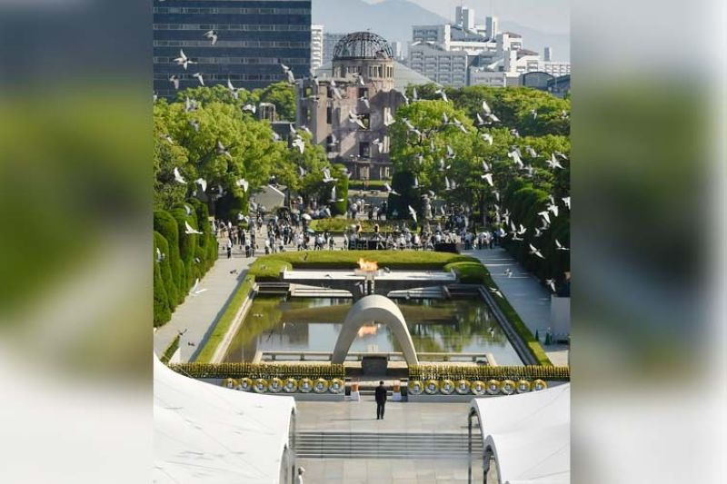Doves fly over the cenotaph dedicated to the victims of the atomic bombing during a ceremony to mark the anniversary of the bombing at Hiroshima Peace Memorial Park in Hiroshima, western Japan Friday, Aug. 6, 2021. Hiroshima on Friday marked the 76th anniversary of the world's first atomic bombing of the city. (AP)