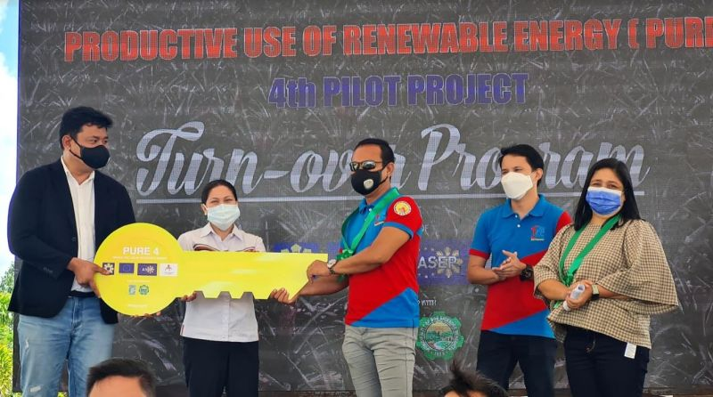 NEGROS. DOE Visayas Field Office Director Russ Mark Gamallo (left) with Ceneco officials led by its acting general manager and project supervisor lawyer Dan Pondevilla (center) during the turnover of Productive Use of Renewable Energy Project in Don Salvador Benedicto on Friday. (Erwin P. Nicavera photo)