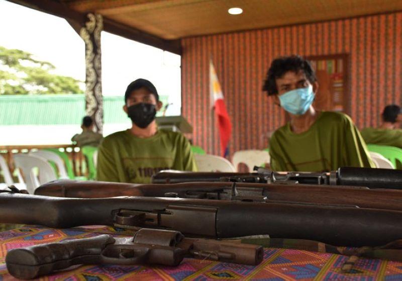 ZAMBOANGA. Four Abu Sayyaf bandits surrender Friday, August 13, to military authorities in Samak village, Talipao, Sulu. A photo handout shows two of the four Abu Sayyaf surrenderers and the firearms they yielded. (SunStar Zamboanga)