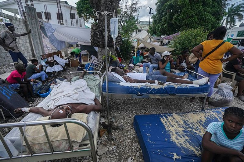 HAITI. Injured people lie in beds outside the Immaculée Conception hospital in Les Cayes, Haiti, Monday, August 16, 2021, two days after a 7.2-magnitude earthquake struck the southwestern part of the country. (AP)