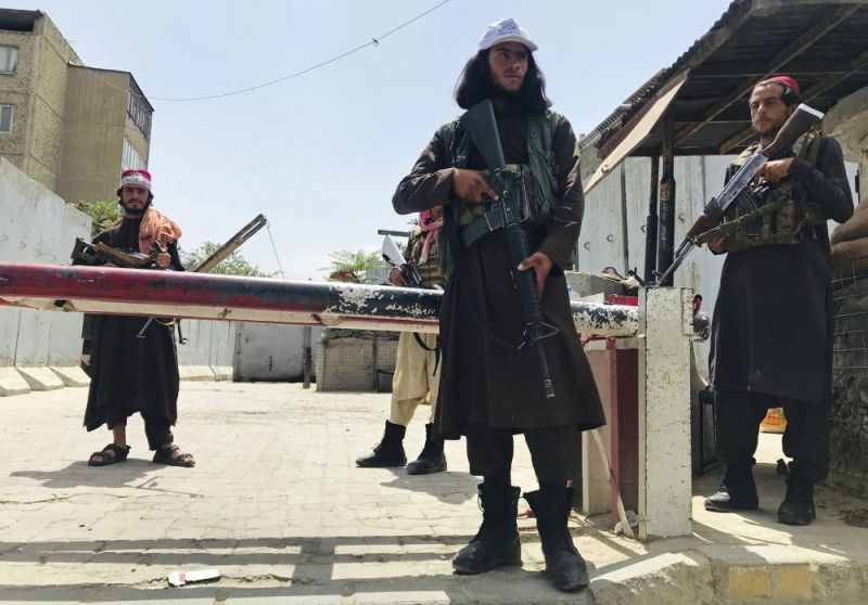 AFGHANISTAN. Taliban fighters stand guard at a checkpoint near the US embassy that was previously manned by American troops, in Kabul, Afghanistan, Tuesday, August 17, 2021. The Taliban declared an