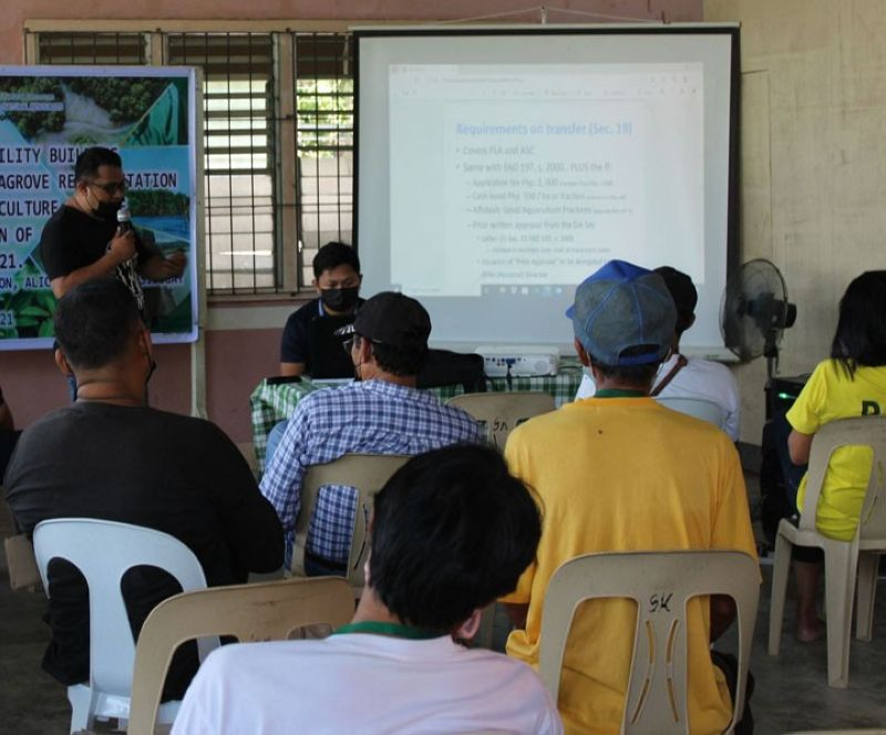 ZAMBOANGA. The Department of Environment and Natural Resources (DENR) facilitates a two-day capability-building seminar on aquasilviculture with emphasis on mangrove crab grow-out culture technology for the members of the fisherfolk association in Concepcion village, Alicia, Zamboanga Sibugay. A photo handout shows the seminar participants (back to the camera) listen intently to a resource speaker from the Bureau of Fisheries and Aquatic Resources. (SunStar Zamboanga)