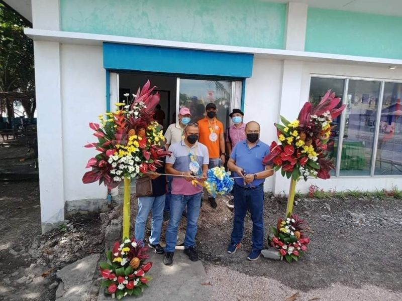 NEGROS. DTI-Negros Occidental Small and Medium Enterprises Development Head Engiemar Tupas (right) and Valladolid Vice Mayor Ruel Yogore (center) lead the opening of Negosyo Center in the locality on Wednesday, August 18, 2021. (Contributed photo)