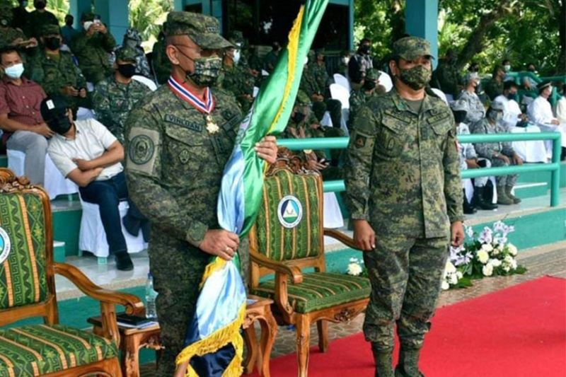 TURNOVER OF COMMAND. Major General Generoso Ponio, 1st Infantry Division commander (right), assumes Tuesday, August 24, 2021, as the acting commander of the Western Mindanao Command (Westmincom), replacing Lieutenant General Corleto Vinluan Jr. (left), who retires from military service. A photo handout shows Vinluan waits for the adjutant (not in photo) to finish reading the order as he readies to handover the command flag to Ponio in a turnover of commander ceremony at Westmincom grandstand. (SunStar Zamboanga)