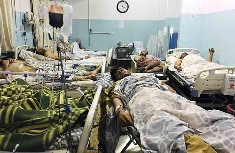 Wounded Afghans lie on a bed at a hospital after a deadly explosion outside the airport in Kabul, Afghanistan, Thursday, Aug. 26, 2021. Two suicide bombers and gunmen attacked crowds of Afghans flocking to Kabul's airport Thursday, transforming a scene of desperation into one of horror in the waning days of an airlift for those fleeing the Taliban takeover. (AP Photo/Mohammad Asif Khan)
