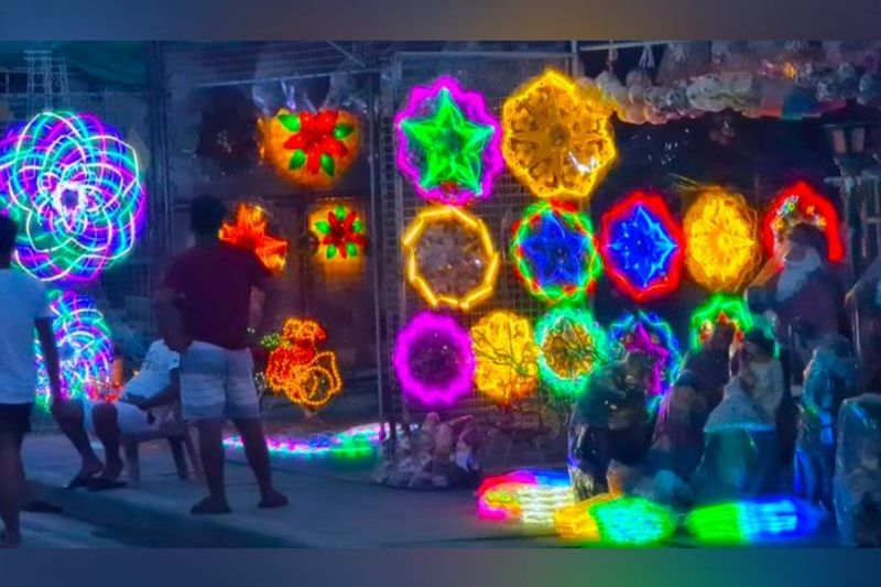 PRELUDE TO CHRISTMAS. Optimistic as ever amid the raging pandemic, lantern makers  have started on Friday, August 27, 2021, displaying and selling colorful Christmas lanterns along the Jose Abad Santos Avenue in Barangay Dolores in the City of San Fernando, Pampanga. (Chris Navarro)