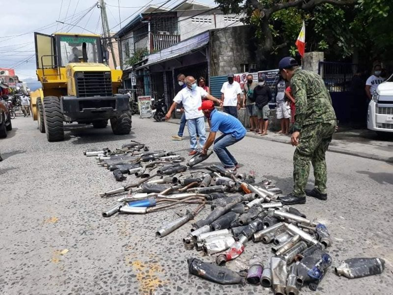 ILLEGAL MUFFLERS. Madapdap Village Chairman Javier Taruc oversees the destruction of illegal mufflers confiscated by the Mabalacat City police. (Mabalacat City photo)