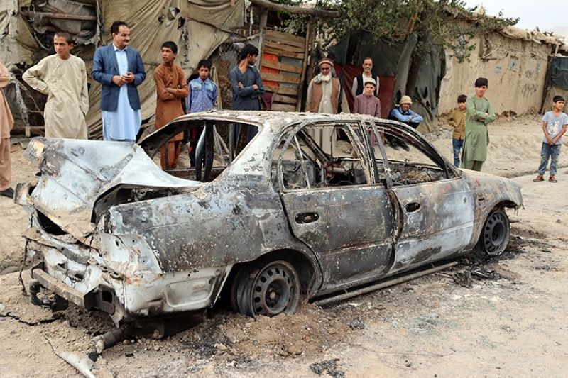 AFGHANISTAN. Locals view a vehicle damaged by a rocket attack in Kabul, Afghanistan on Monday, August 30, 2021. (AP)