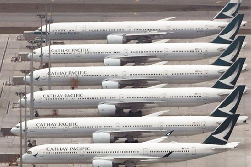 PANDEMIC IMPACT. Cathay Pacific says it is highly dependent upon operational and customer travel restrictions being relaxed to achieve better results this year. / AP