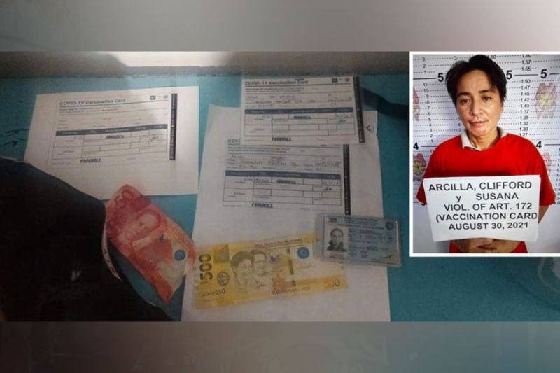 ENTRAPMENT Forty-six-year-old Clifford Arcilla was arrested by elements of the Carbon Police Station after he was caught red-handed faking vaccination cards on Sanciangko St., Cebu City. If found guilty, he faces a jail sentence and a court-imposed fine for falsification of public documents. / Carbon Police Station