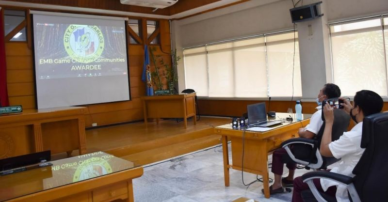 CHAMPION. City Environment Management Office Head Engineer Loreto C. Sanchez (in front of laptop) attends the awarding ceremony through Zoom meeting at the SP session hall Wednesday, September 1, 2021. (Contributed photo)