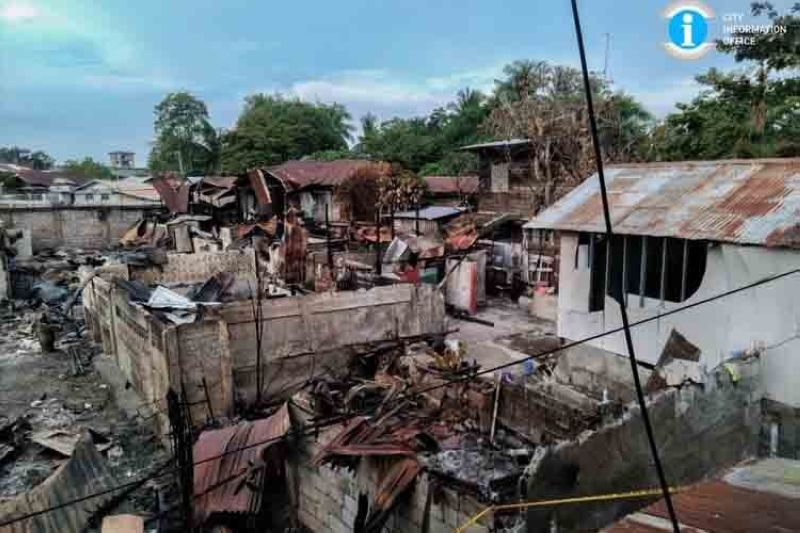 The image of the devastating fire in san Carlos City Tuesday. (Contributed photo)