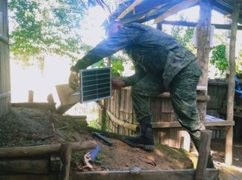 PERIMETER LIGHTS. The Army's 53rd Infantry Battalion (IB) installs solar-powered flood lights to boost security especially at night at the militia patrol base in Balonia village, Midsalip, Zamboanga del Sur. A photo handout shows a 53IB troops installs one of the solar panels at the militia outpost. (SunStar Zamboanga)