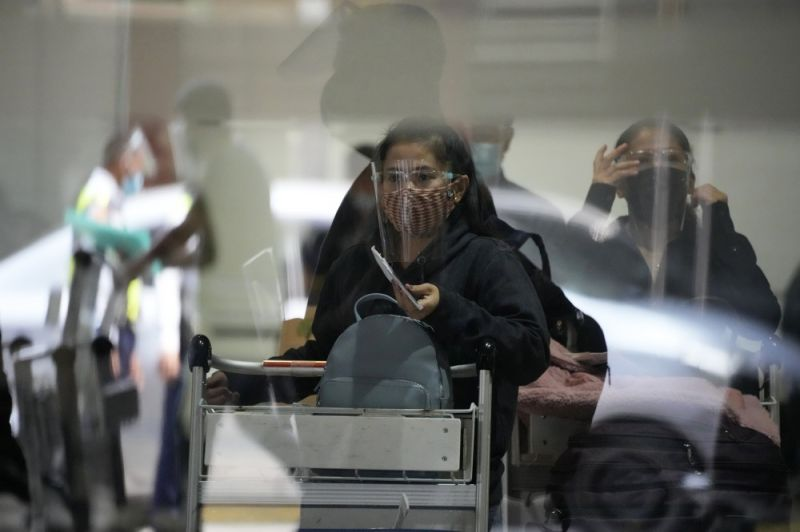 Passengers wait for their ride as they arrive at Manila's International Airport, Philippines on Monday, September 6, 2021. (AP Photo)