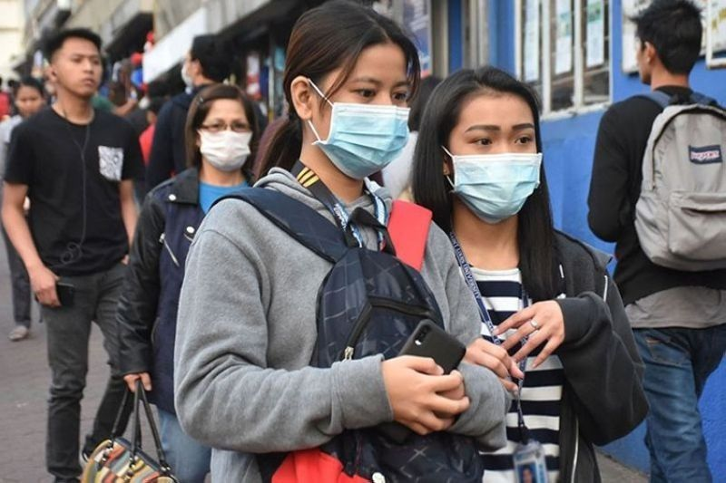 Employees now required to wear air purifiers, masks. (File photo)