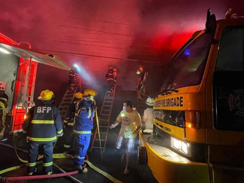 BACOLOD. Firefighters from the Bureau of Fire Protection and fire volunteer groups put out the fire that razed one of the buildings of the Mansilingan Agro-Industrial High School in Barangay Mansilingan, Bacolod City nearly midnight Tuesday, September 7, 2021. (Arthur Yap photo)
