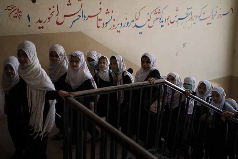 AFGHANISTAN. Girls walk upstairs as they enter a school before class in Kabul, Afghanistan, Sunday, September 12, 2021. (AP)