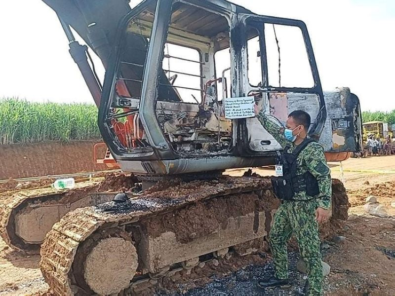 NEGROS. The backhoe torched by the suspected rebels in Barangay Carabalan in Himamaylan City over the weekend. (Contributed photo)