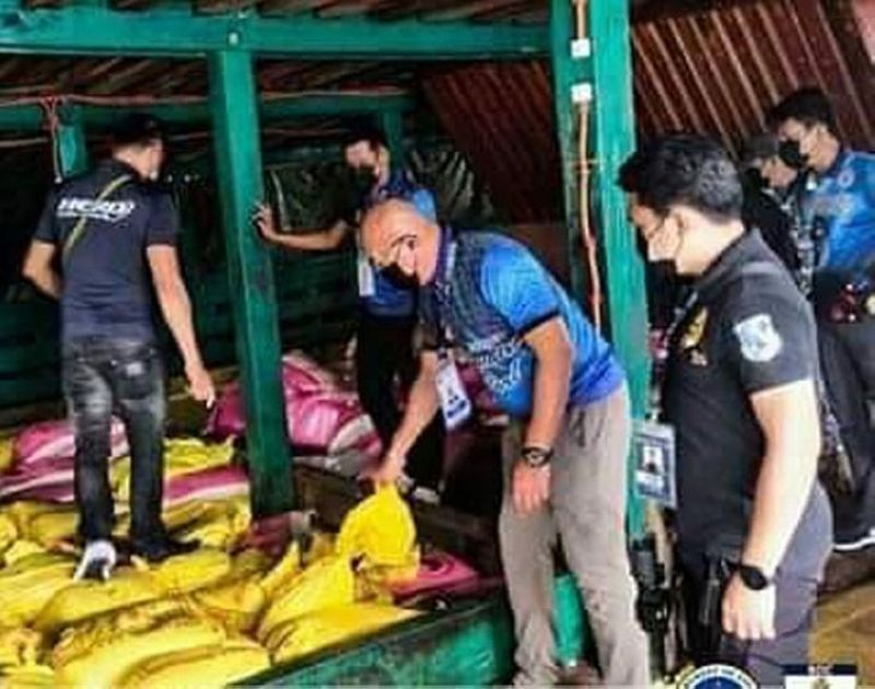 SMUGGLED RICE. The Bureau of Customs (BOC) and Philippine Coast Guard (PCG) seize a shipment of P15 million worth of smuggled rice on Sunday, September 12, off Bongao, Tawi-Tawi. A photo handout shows BOC and PCG personnel inspecting the cargo hold of M/V Eshan Khan that was caught transporting smuggled rice. (SunStar Zamboanga)