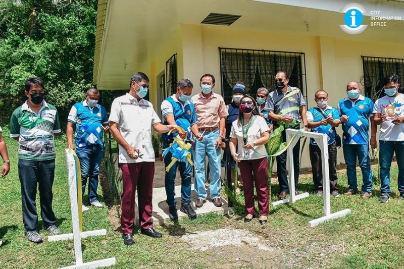NEGROS. The City Government of San Carlos headed by Mayor Renato Gustilo inaugurates two newly completed projects in Barangay Punao in the city recently. (Contributed photo)
