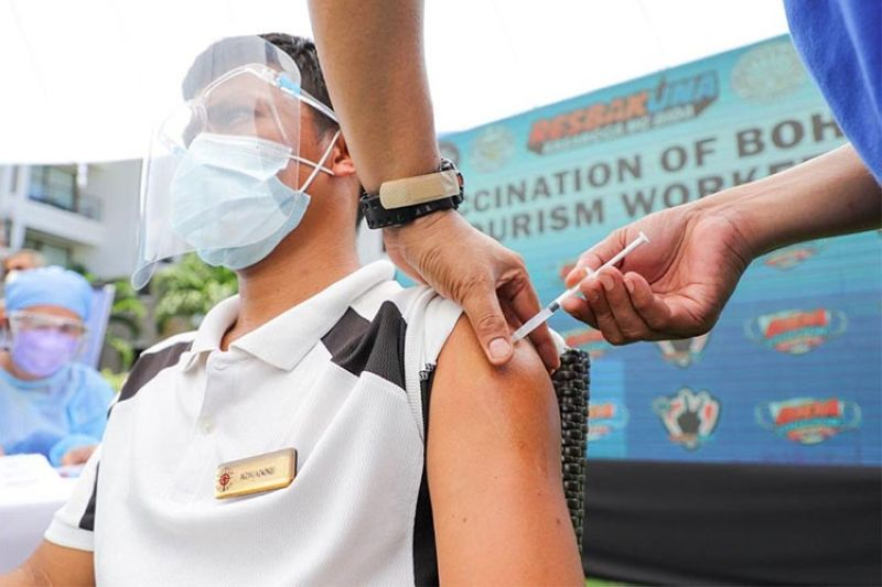 PROTECTION. Vaccinating tourism workers is the only way the tourism sector can continue to sustain the recovery of domestic tourism, Tourism Secretary Bernadette Puyat says. (Photo from DOT website)