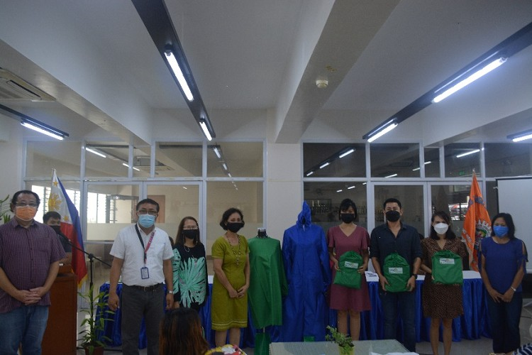 NEGROS. CHMSC turns over the PPE sets to Bayanihan Mission representatives on September 16. (Contributed photo)