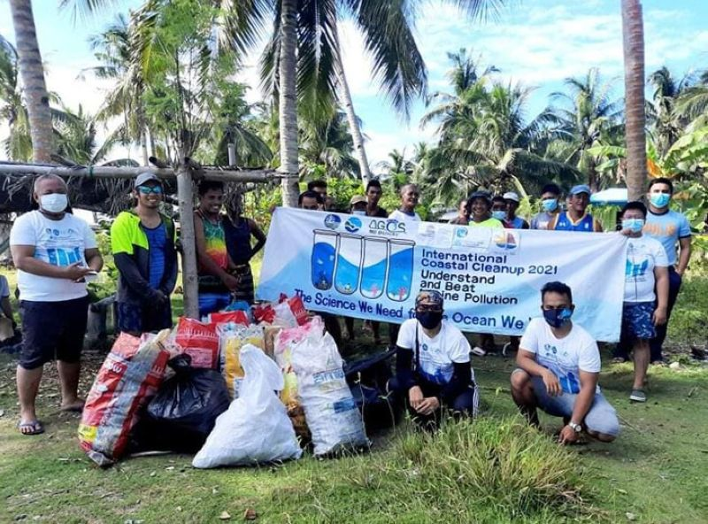 COASTAL CLEANUP. The Department of Environment and Natural Resources together with the Philippine Coast Guard conduct a series of activities Saturday, September 18, on Aliguay Island, Dapitan City, Zamboanga del Norte, in celebration of the International Coastal Cleanup Day. A photo handout shows the participants posing for a souvenir photo along with the sacks of trash they collected during the activity. (SunStar Zamboanga)