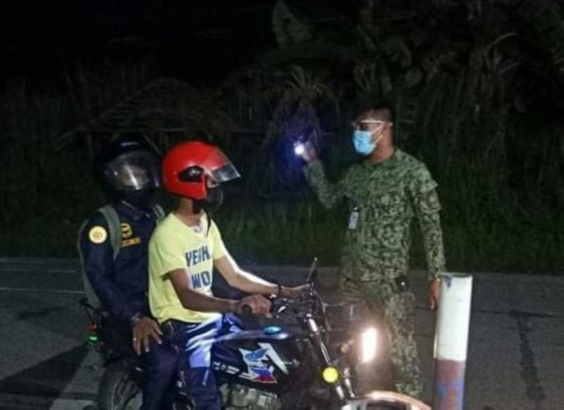 BACOLOD. A policeman conducts a checkpoint during the curfew hours in Bacolod City. (Contributed photo)