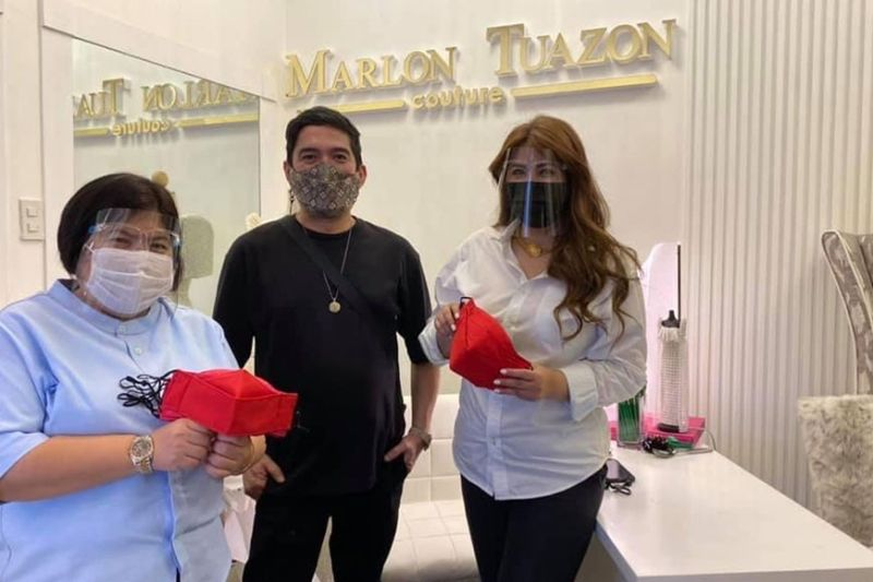 FACE MASK DONATION. Mayor Carmelo Lazatin's Chief Adviser IC Calaguas and Executive Assistant IV Reina Manuel show the face masks made by Angeleño designer Marlon Tuazon, which he donated to Bale Pusu, the first ever city-operated home for the homeless/abandoned elderly which opened September 15 and can house eight to 12 homeless female senior citizens. (Angeles City Information Office)