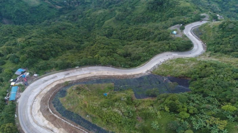 A slide-prone portion of Cebu – Balamban – Transcentral Highway is now much safer with the recent completion of a slope protection project along the road in Barangay Cansomoroy, Balamban, Cebu. (Photo courtesy of DPWH)