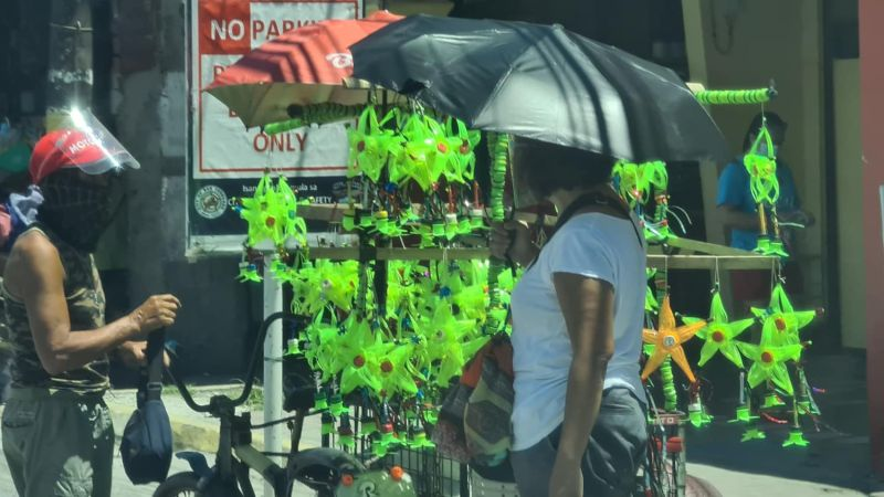 PAMPANGA. A street vendor at the old public market in the City of San Fernando sells recycled mini Christmas lanterns made of plastic bottles, turning garbage into something useful and at the same time celebrating the spirit of the upcoming Holiday Season. (Chris Navarro)