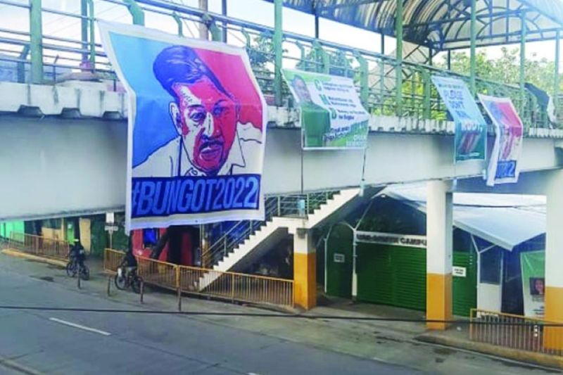 RUNNING OR NOT. Posters with the picture of Land Transportation Office (LTO) Central Visayas Director Victor Emmanuel Caindec hang at the skywalk on V. Rama Street in Cebu City, suggesting that the government official is set to run for an elective position in next year's elections. However, Caindec denied he is running for any position next year. / Alan Tangcawan