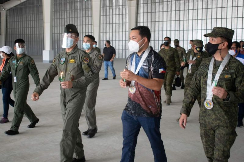 NEW HANGAR. DPWH Secretary Mark Villar and officials of Fort Magsaysay led by Army Aviation Regiment Commander Colonel Andre B. Santos inspect the brand new hangar at the Fort Magsaysay. (DPWH photo)