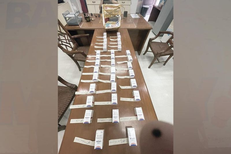 SMUGGLED BY STUDENT. A cold storage box consigned to third year medical student Raisa Ong yields 10 vials of illegally imported Tocilizumab and 25 boxes of Baricitinib tablets at the Mactan-Cebu International Airport in Lapu-Lapu City, Cebu on Sept. 14, 2021. These are drugs used in the treatment of Covid-19. / NBI FACEBOOK PAGE