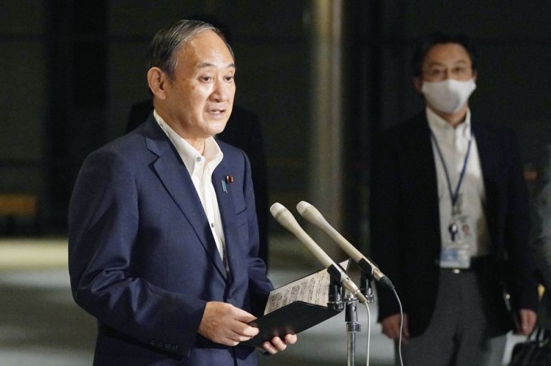 Japanese Prime Minister Yoshihide Suga speaks to reporters about lifting of a state of emergency at his official residence in Tokyo Monday, September 27, 2021. Suga is expected to announce on Tuesday, September 28, 2021 a lifting of the ongoing coronavirus state of emergency and less-stringent measures in all 27 prefectures including Tokyo when they expire at the end of September as the infections slow and the nation tries to reactivate its economy. (AP Photo)
