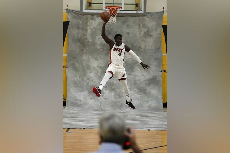 FUN. Miami Heat's Victor Oladipo jumps as he poses for a photographer during the NBA basketball team's Media Day in Miami, Monday, Sept. 27, 2021. / AP