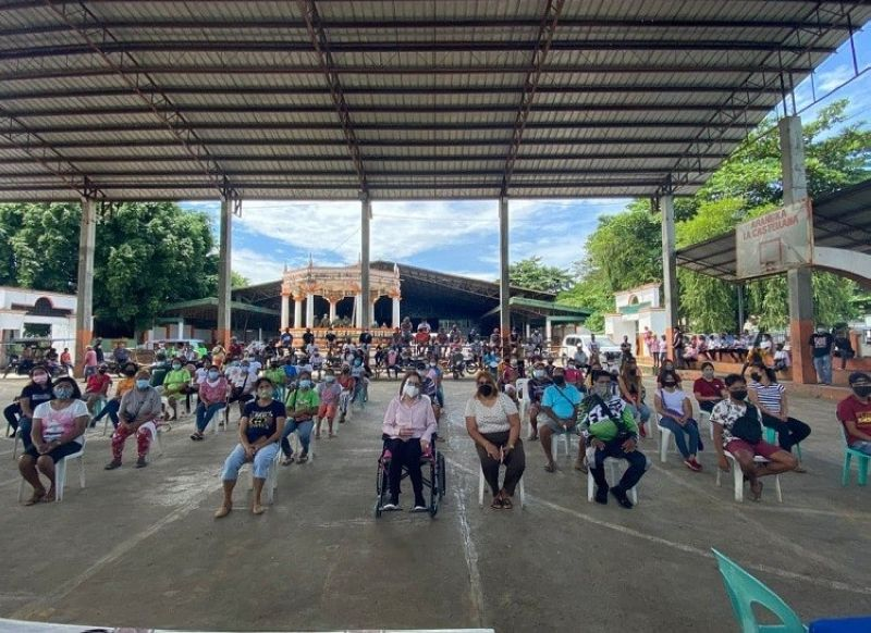 NEGROS. Some 141 displaced workers from four barangays in La Castellana receive their emergency employment assistance recently. (Contributed photo)