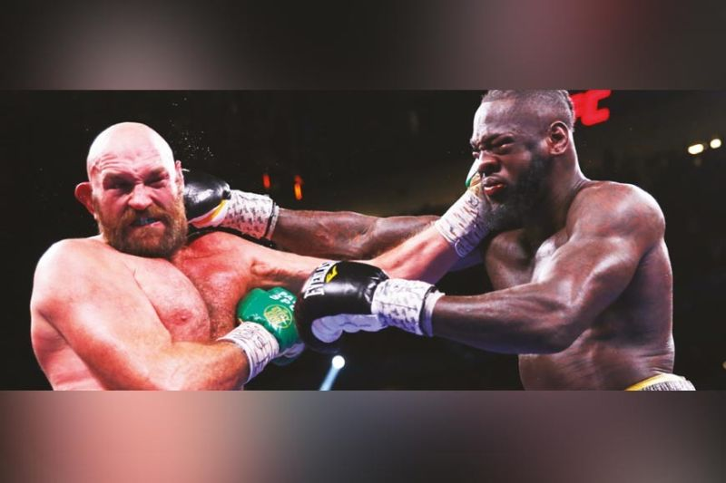 WILD TRILOGY. Tyson Fury (left) and Deontay Wilder (right) trade heavy blows in Las Vegas, USA on Sunday (PH time), Oct. 10, 2021. / AP
