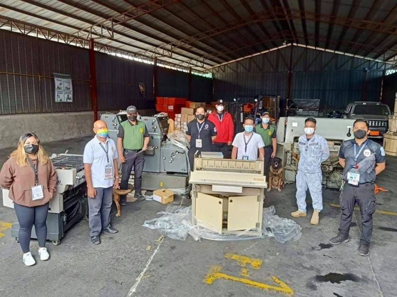 CONFISCATED. Bureau of Customs Port of Cebu and other government personnel show the printing machinery from Japan that they seized on Oct. 5, 2021 for not having a pre-shipment importation clearance from the Department of Environment and Natural Resources. / BOC PORT OF CEBU FACEBOOK PAGE
