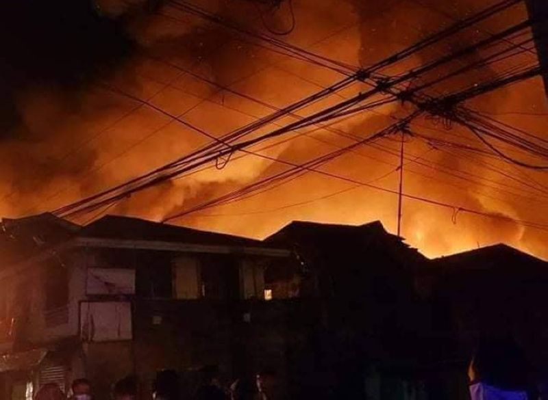 FIRE INCIDENT. One person was injured while some P4 million worth of properties were destroyed in a more than 3-hour fire early Wednesday that hit a slum community in Recodo village, Zamboanga City. A photo handout shows flame engulfingthe house that are mostly made from light materials. (SunStar Zamboanga)
