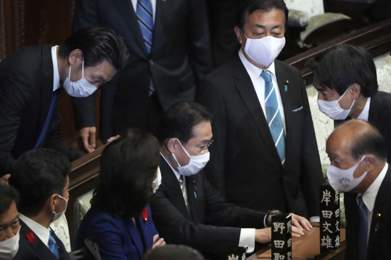 JAPAN. Japanese Prime Minister Fumio Kishida, center, and other lawmakers speak before dissolving the lower house, at an extraordinary Diet session at the lower house of parliament Thursday, October 14, 2021, in Tokyo. Japan's new Prime Minister Kishida dissolved the lower house of parliament Thursday, paving the way for October 31 national elections.(AP Photo)