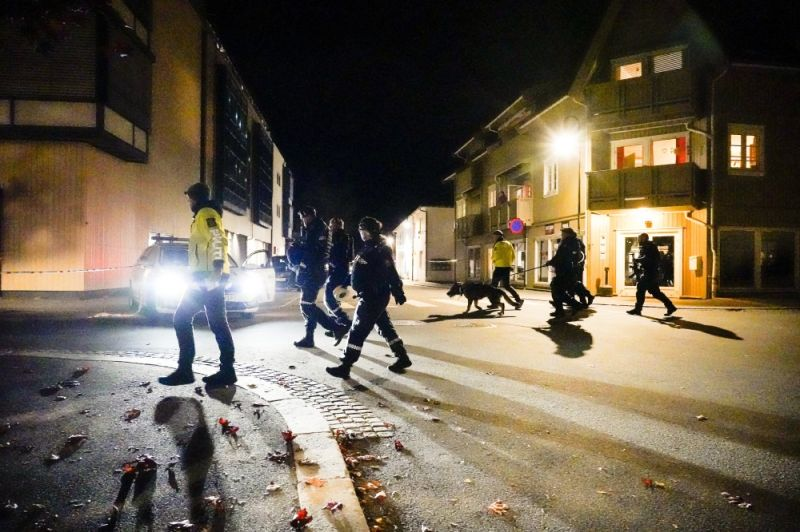 NORWAY. Police walk at the scene after an attack in Kongsberg, Norway, Wednesday, October 13, 2021. Several people have been killed and others injured by a man armed with a bow and arrow in a town west of the Norwegian capital, Oslo. (AP)