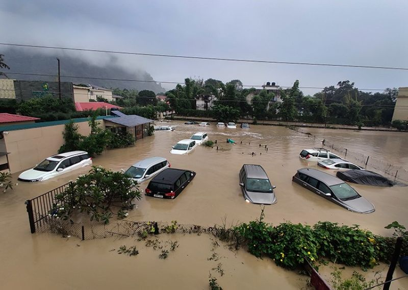 Submerged cars are seen at a flooded hotel resort as extreme rainfall caused the Kosi River to overflow at the Jim Corbett National Park in Uttarakhand, India, Tuesday, Oct. 19, 2021. More than 20 people have died and many are missing in floods triggered by heavy rains in the northern Indian state of Uttarakhand, officials said Tuesday. (AP Photo/Mustafa Quraishi)