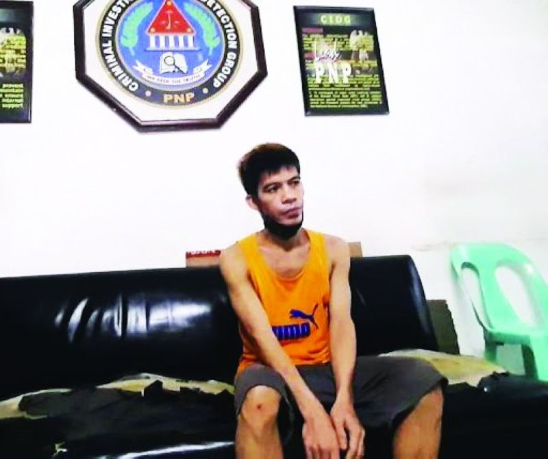 NABBED. Alleged maker of counterfeit bills, Joseph Mercado Salas, 36, sits on the sofa inside the office of the Criminal Investigation and Detection Group Central Visayas after his arrest in Barangay San Nicolas, Cebu City on Tuesday night, Oct. 19, 2021. / ARNOLD BUSTAMANTE