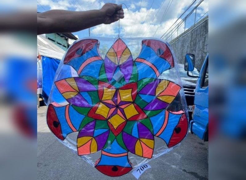 ZAMBOANGA. The persons deprived of liberty (PDL) at the Zamboanga City Reformatory Center (ZCRC) embark on a lantern-making activity in time for the coming Yuletide season. A photo handout shows a buyer displaying the lantern he bought at P700. (SunStar Zamboanga)