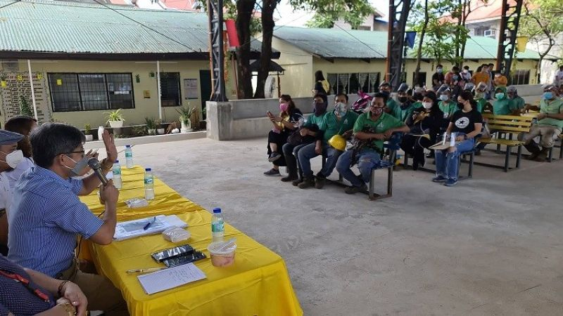 HEARING. Filomeno C. Eufemia Jr., acting election officer and chairman of election registration board in San Simon town listens to the sentiments of the employees of Real Steel Corporation during Wednesday's hearing regarding their transfer of residency. (Chris Navarro)