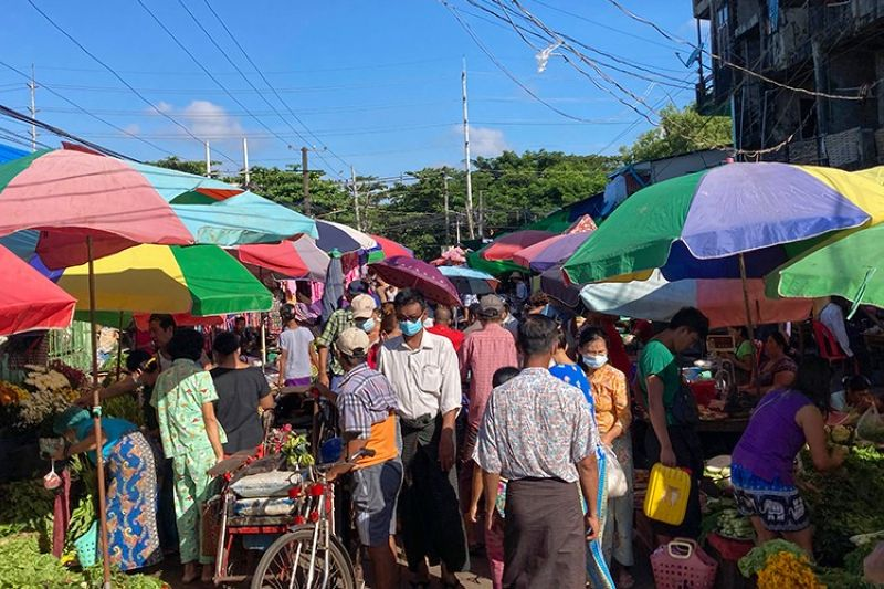 MYANMAR. People walk through a crowded street market Sunday, October 24, 2021 in Yangon, Myanmar. (AP)
