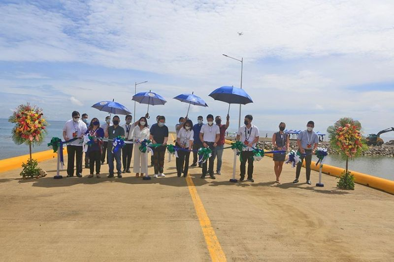 NEW PORT. Government officials and executives of the Topline Group of Companies inaugurate Pier 88, a new port in Liloan, Cebu, on Sunday, Oct. 24, 2021. Pier 88 is the port of call of Topline Seabus, which will start ferrying passengers to Mactan Island in the first quarter of 2022. (Alan Tangcawan)